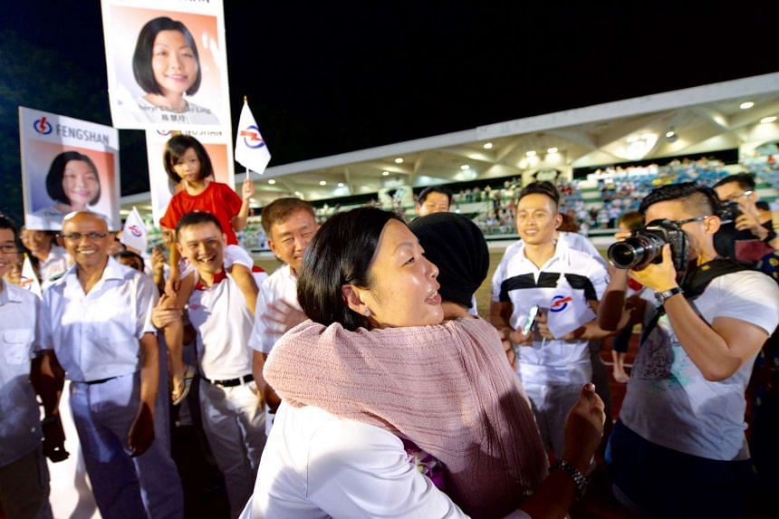 PAP's Cheryl Chan Wei Ling thanking a supporter after being declared the winner for Fengshan SMC.