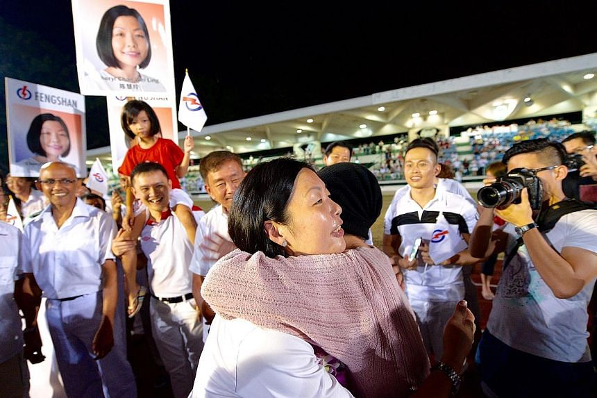 Ms Cheryl Chan getting a congratulatory hug last night after being declared the winner for Fengshan.