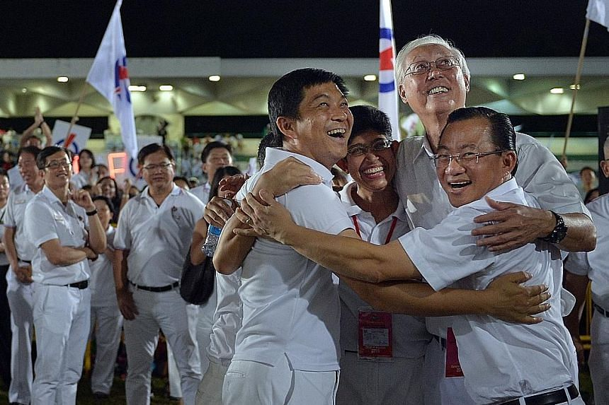 (From left) WP's Mr Terence Tan, Mr Yee Jenn Jong, Mr Daniel Goh, Ms He Tingru, Mr Firuz Khan, and Mr Dylan Ng waiting for the results at Hougang Stadium.