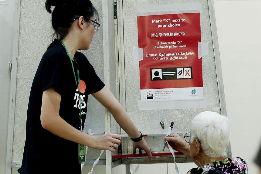 Resident Ho Ku Wan, 94, casting her vote at a polling station in Toa Payoh. Since GE2011, the PAP has provided more help for the low- and middle-income groups as well as the elderly.