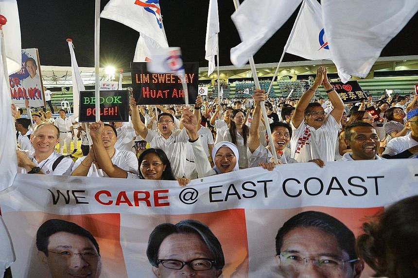 Jubilant PAP supporters greet the East Coast GRC team, comprising Mr Lim Swee Say, Mr Lee Yi Shyan, Dr Mohamad Maliki Osman and Ms Jessica Tan, with a rockstar reception.