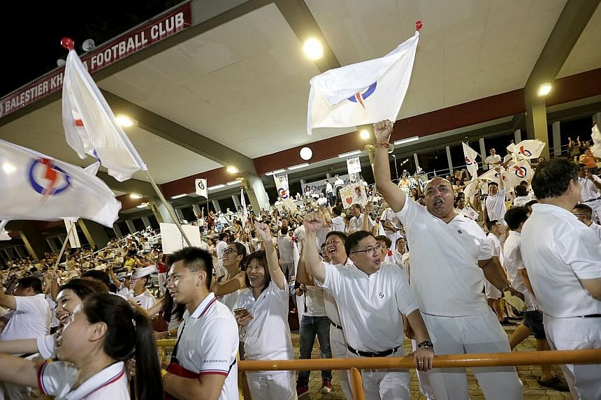 Jubilant PAP supporters at Toa Payoh Stadium cheering as the results are announced.