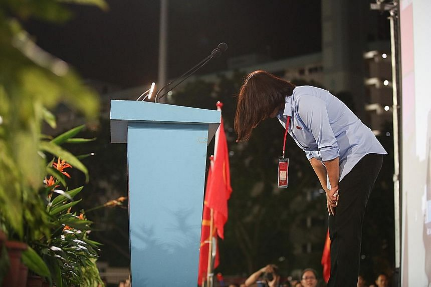 From top: A disappointed Workers' Party supporter at Hougang Stadium having a quiet moment; Workers' Party Punggol East candidate Lee Li Lian bowing as she thanks her supporters at Hougang Stadium; Singapore Democratic Party chief Chee Soon Juan deli