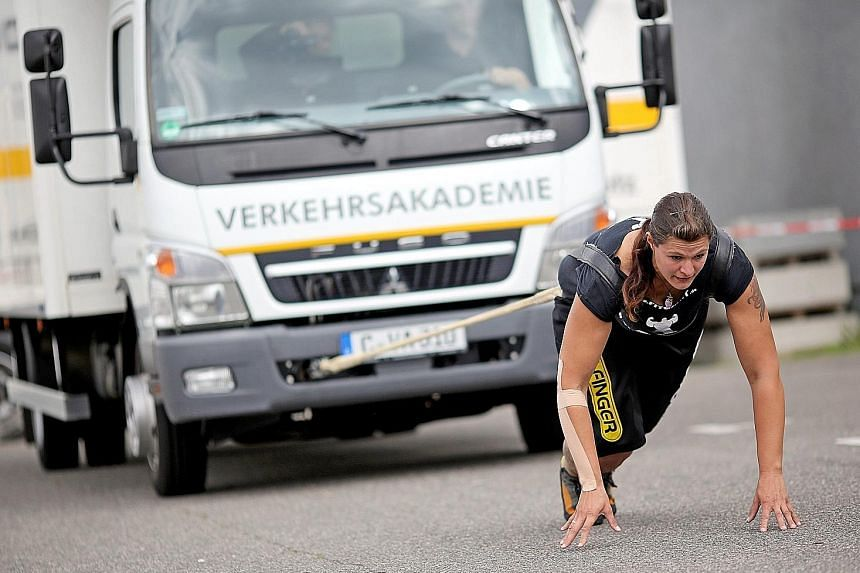 Kathleen Krausse, the first female German truck pull champion, pulls a 7.5-tonne truck in Chemnitz, Germany, on Thursday. This year's European Truck Pull Championships will be held in Chemnitz on Oct 3 and 4.