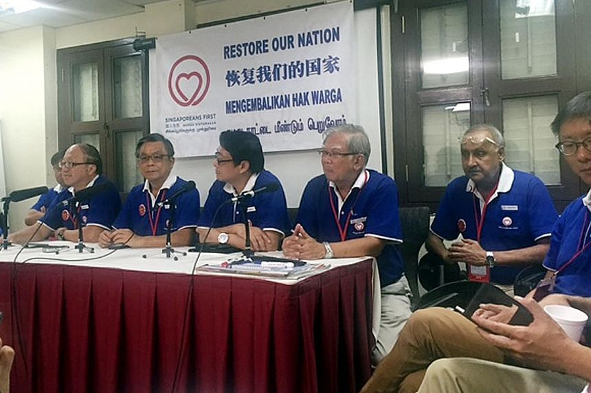 The mood was sombre as SingFirst's party members held a press conference at its operations centre in Tras Street.