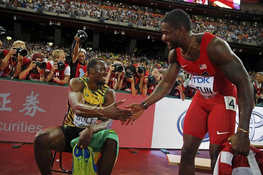 Usain Bolt (far left) shakes hands with Justin Gatlin after winning the 200m final at the World Championships in Beijing. The Jamaican once again proved that he can be counted on to deliver on big occasions.