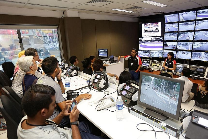 ST readers enjoy a rare chance to be at the starting line and control room (far left). The race here has been labelled the crown jewel of Formula One.