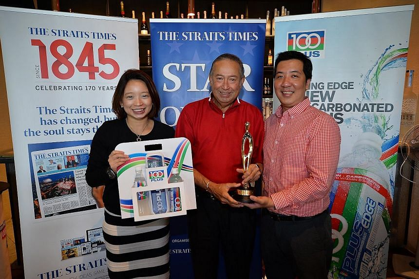 Far left: Colin Schooling (centre), father of Singapore swimmer Joseph, receiving the ST Athlete of the Month trophy from Straits Times sports editor Marc Lim. With them is Celine Tan, marketing manager of F&N.