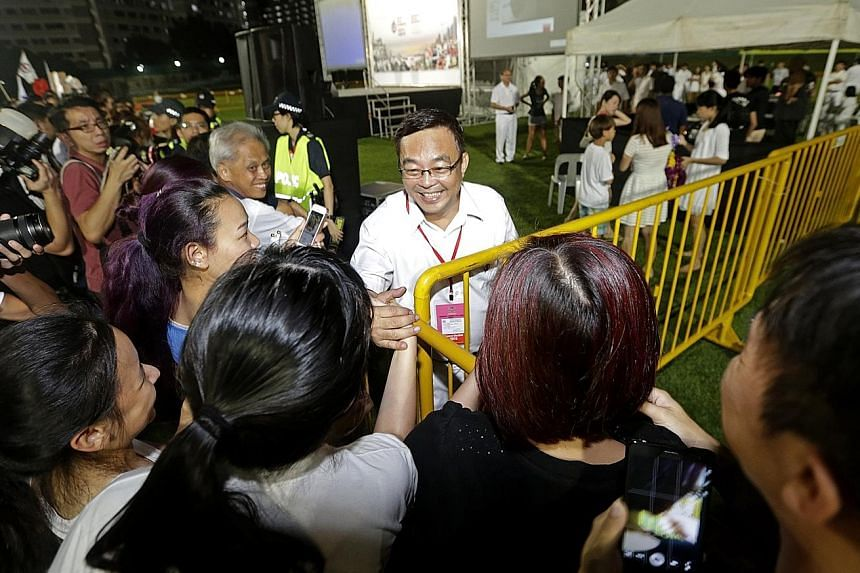 Mr Cedric Foo (left) retained Pioneer for the PAP, while Hong Kah North voters gave their MP Amy Khor another term.