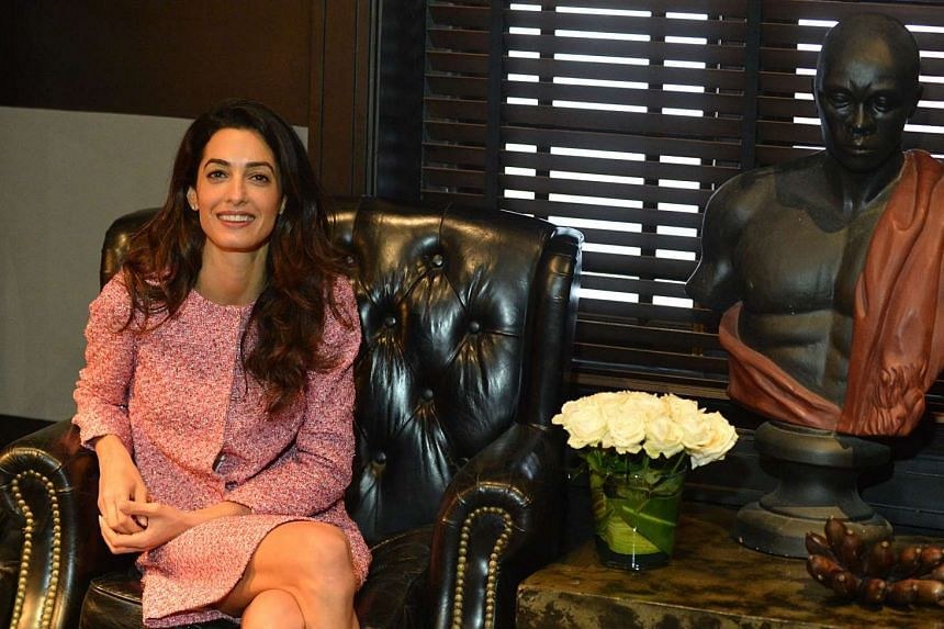 London-based human rights lawyer Amal Clooney meets members of the media at a hotel in the Sri Lankan capital Colombo.