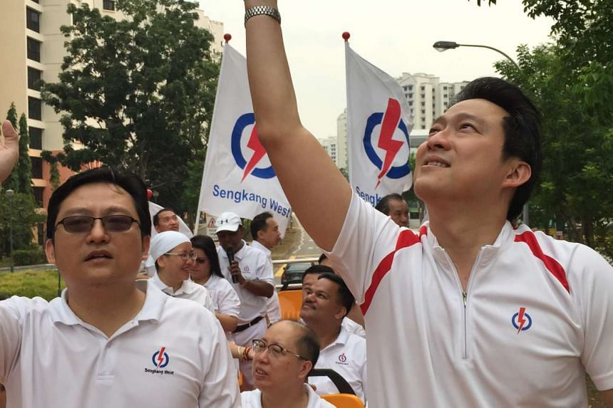 Dr Lam (right) won 62.1 per cent of the vote against the Worker's Party's Koh Choong Yong.