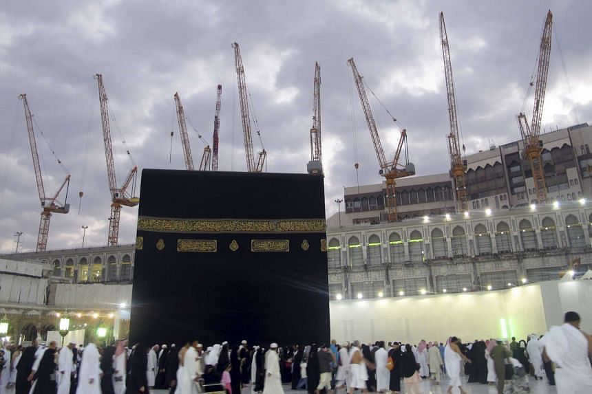 Construction cranes surround the Grand Mosque in the holy city of Mecca in this Jan 6, 2013 file photo.