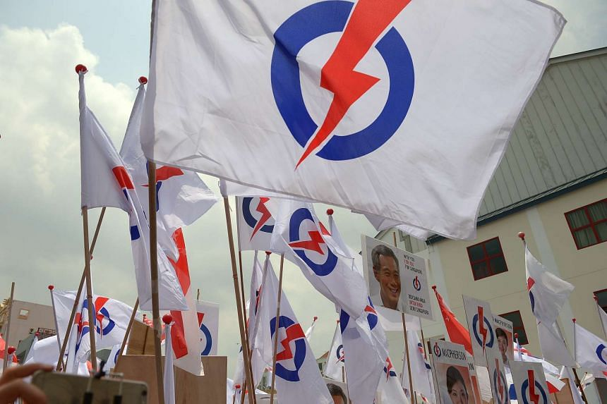 PAP supporters waving party flags at Kong Hwa School on Nomination Day, Sept 1, 2015.