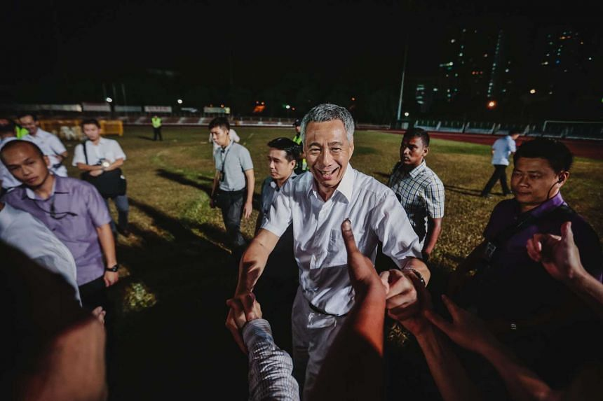 PM Lee Hsien Loong greeting supporters at Toa Payoh Stadium on Sept 11, 2015.