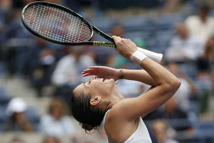 Pennetta reacts after defeating Simona Halep.