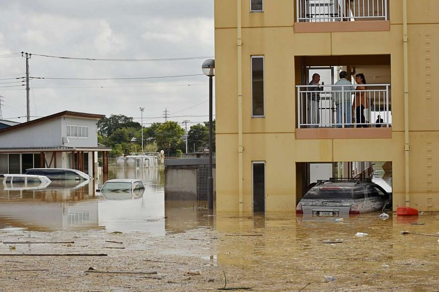 Residents in a flooded apartment wait for a rescue mission in the city of Joso in Ibaraki prefecture on Sept 12, 2015.