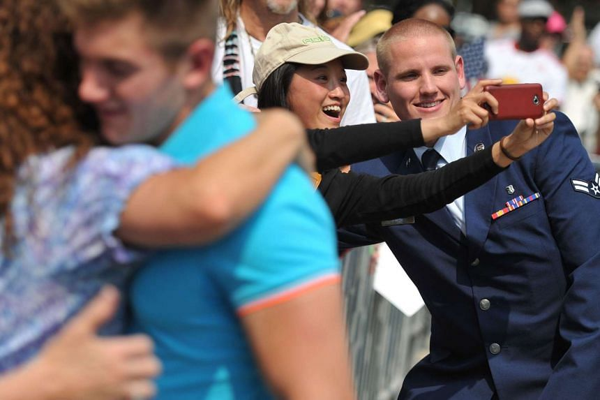 US servicemen Spencer Stone (right) and Alek Skarlatos (left) greet fans during a celebration honouring them in Sacramento.