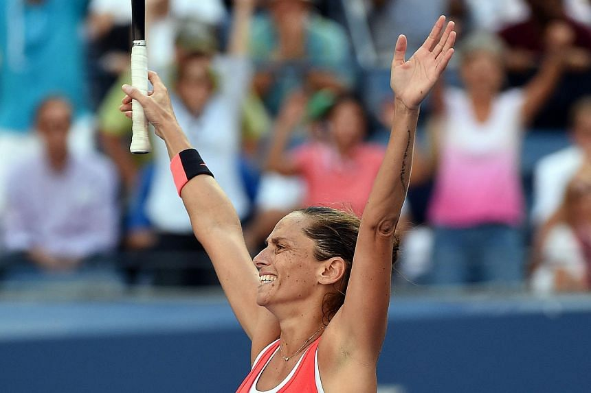 Roberta Vinci of Italy celebrates defeating Serena Williams of the US during their semi finals match in New York on Sept 11, 2015.