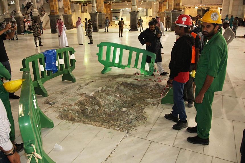 Saudi emergency teams gather at the site of accident in the Grand Mosque of Saudi Arabia's holy Muslim city of Mecca on Sept 12, 2015, after a construction crane crashed into it.