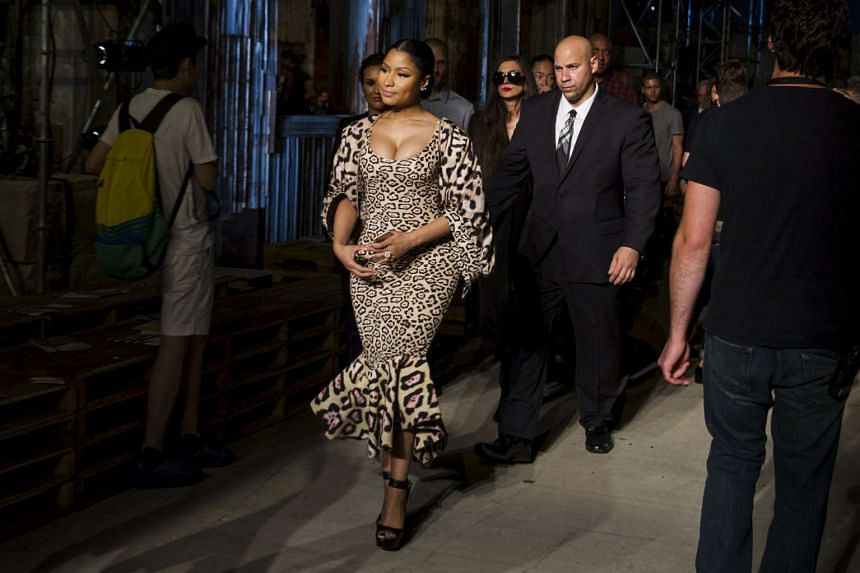 Singer Nicki Minaj departs after a presentation of the Givenchy Spring/Summer 2016 collection during New York Fashion Week in New York on Sept 11, 2015.