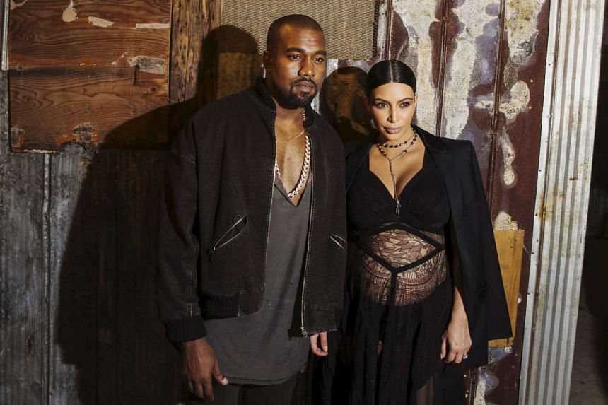 Musician Kanye West stands with his wife Kim Kardashian after watching the Givenchy Spring/Summer 2016 collection during New York Fashion Week in New York on Sept 11, 2015.