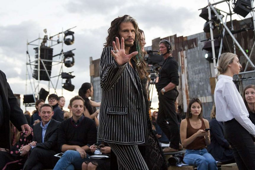 Singer Steven Tyler arrives with his daughter Liv for a presentation of the Givenchy Spring/Summer 2016 collection during New York Fashion Week in New York on Sept 11, 2015.