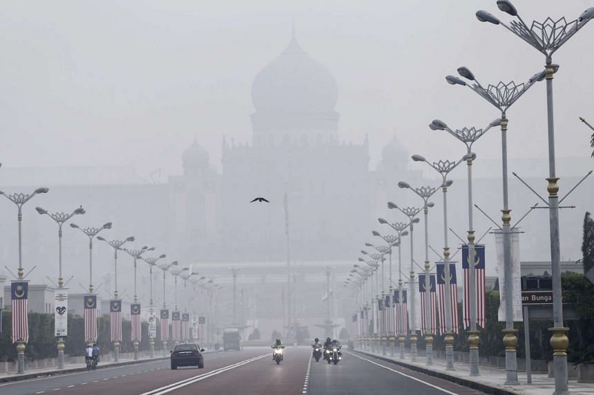 The Malaysian Prime Minister's office building in Putrajaya shrouded by thick haze on Sept 12, 2015.