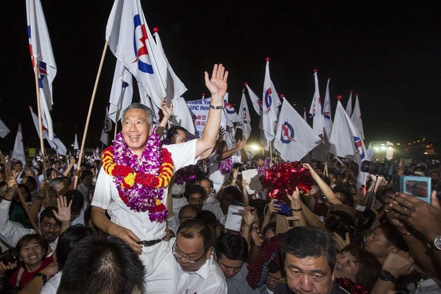Prime Minister Lee Hsien Loong, leader of the People's Action Party (PAP), celebrating the election results with supporters on Sept 12, 2015.