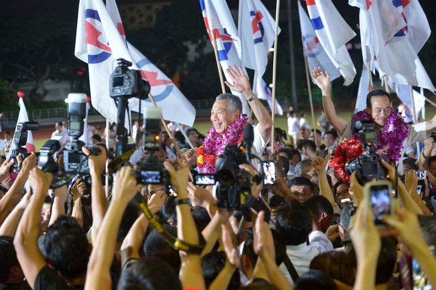 PAP supporters carrying PM Lee Hsien Loong in celebration at Toa Payoh Stadium on Sept 12, 2015.