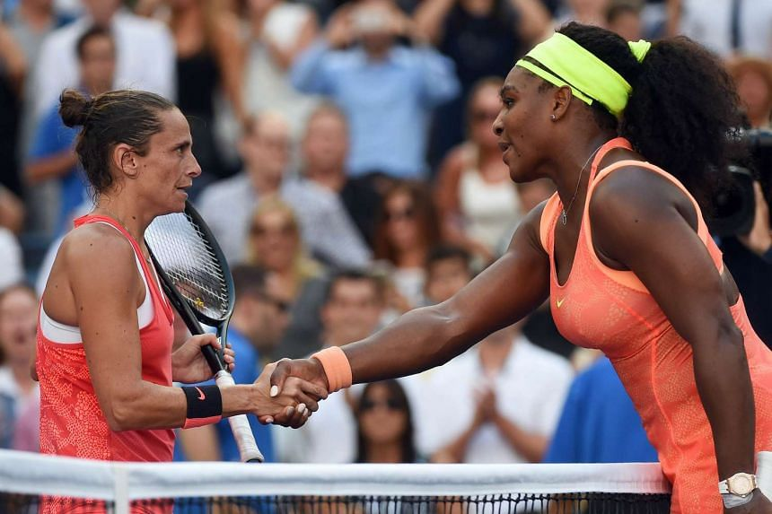 Vinci is congratulated by Williams at the end of their match.
