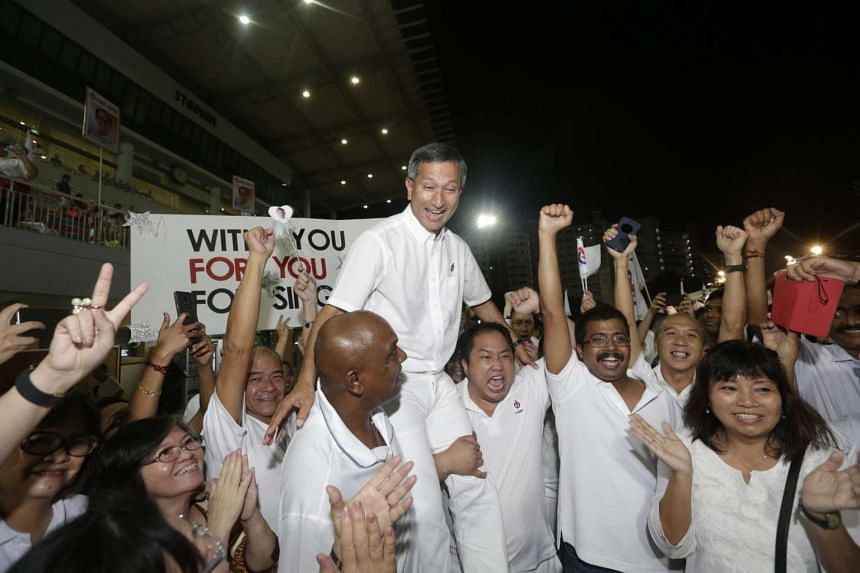 Environment and Water Resources Minister Vivian Balakrishnan being hoisted by jubilant supporters at Jurong West Stadium. Residents of private and public housing estates in Holland-Bukit Timah GRC voted the same way, he said, which spoke well for the