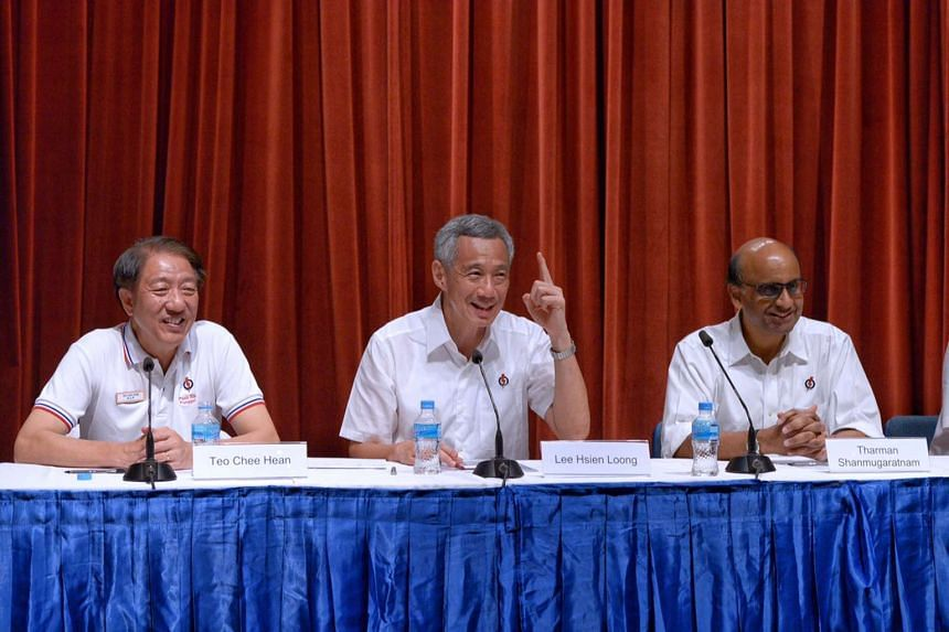 Prime Minister Lee Hsien Loong holding his press conference early this morning, flanked by Deputy Prime Ministers Teo Chee Hean and Tharman Shanmugaratnam. PM Lee said he was happy and ''deeply humbled'' by the strong mandate given to the PAP, and he
