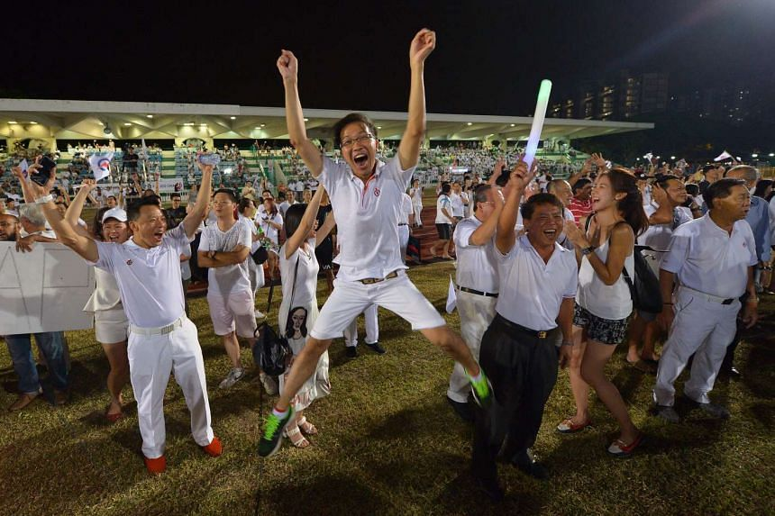 For many PAP supporters, it was a night to remember. Mr Kenneth Wong, 30, a PAP activist with Marine Parade GRC, jumping for joy at Bedok Stadium last night.