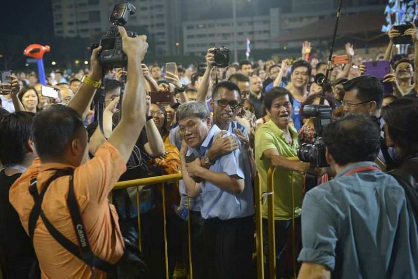 Mr Png Eng Huat thanking supporters at the Hougang Stadium after his win was announced.