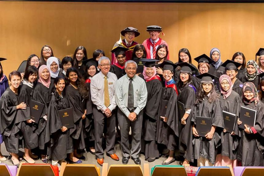 Some of the students of private school DAS Academy who graduated yesterday, with Senior Parliamentary Secretary for Education and Manpower Hawazi Daipi (centre, in green shirt).
