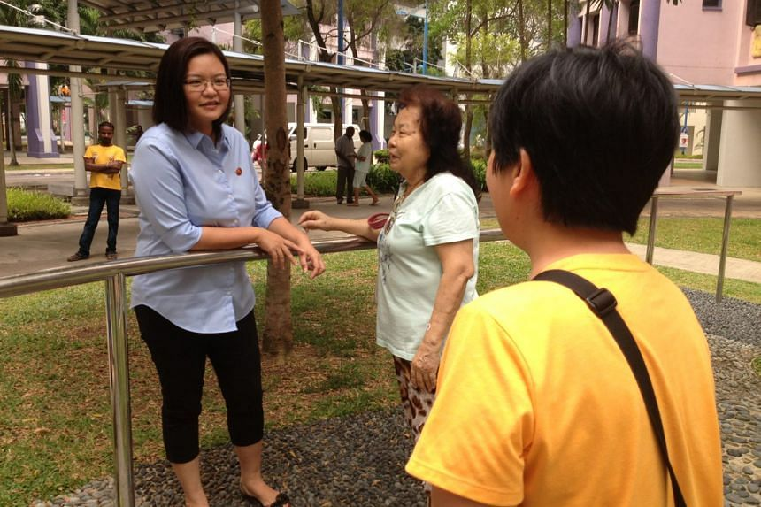 Punggol East residents come up to WP's Ms Lee Li Lian, who lost her seat, to give her a hug.