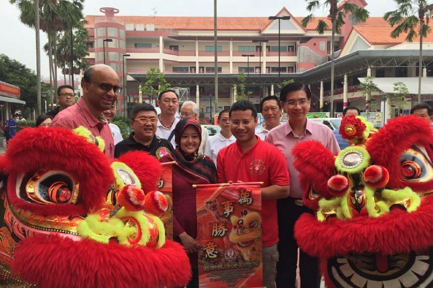 DPM Tharman Shanmugaratnam (far left) and his Jurong GRC team are welcomed with a lion dance in Jurong West Street 52.