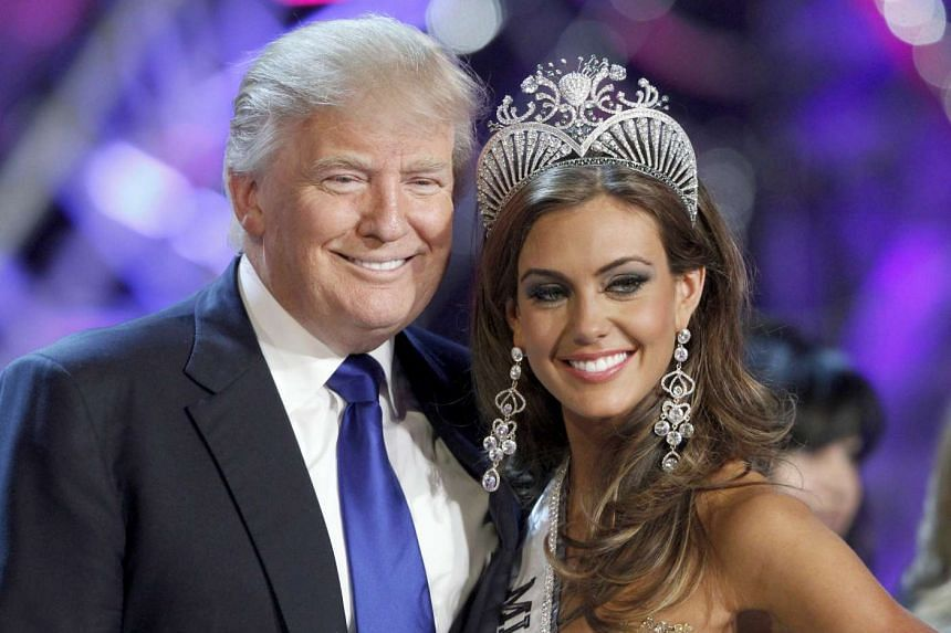 Donald Trump poses with Miss USA 2013 Erin Brady in a file photo.