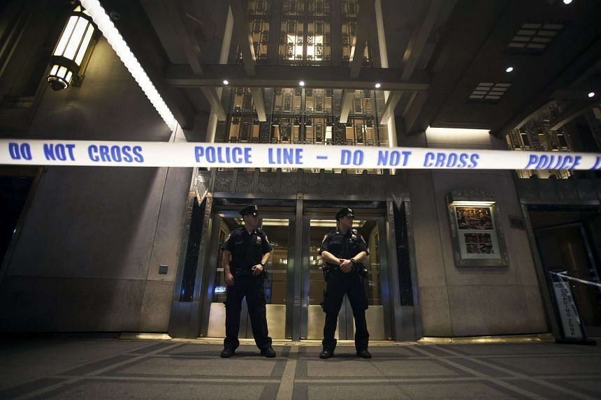 Police stand guard at the main entrance to the Waldorf Astoria Hotel following a shooting in the lobby during a wedding on June 13, 2015. A gun was said to have gone off accidentally.