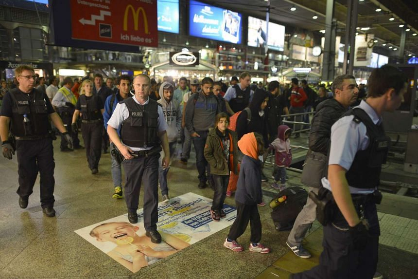 Migrants arriving at the central station in Munich, southern Germany, on Sept 12, 2015.