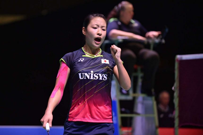 Japan's Nozomi Okuhara celebrating after scoring a point against compatriot Akane Yamaguchi during their women's singles final match at the Japan Open Superseries badminton tournament in Tokyo on Sept 13, 2015.