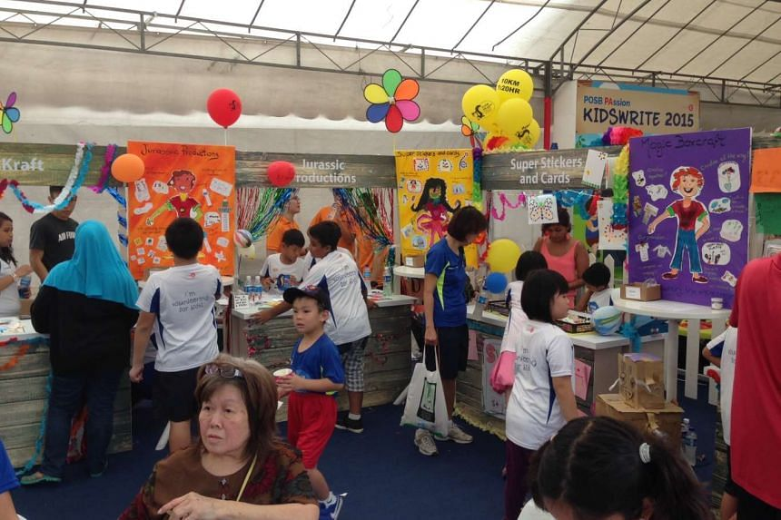 """There were nine """"company"""" booths run by 39 children at the Kids' Bazaar at the Marina Bay Promontory on Sept 13, 2015."""