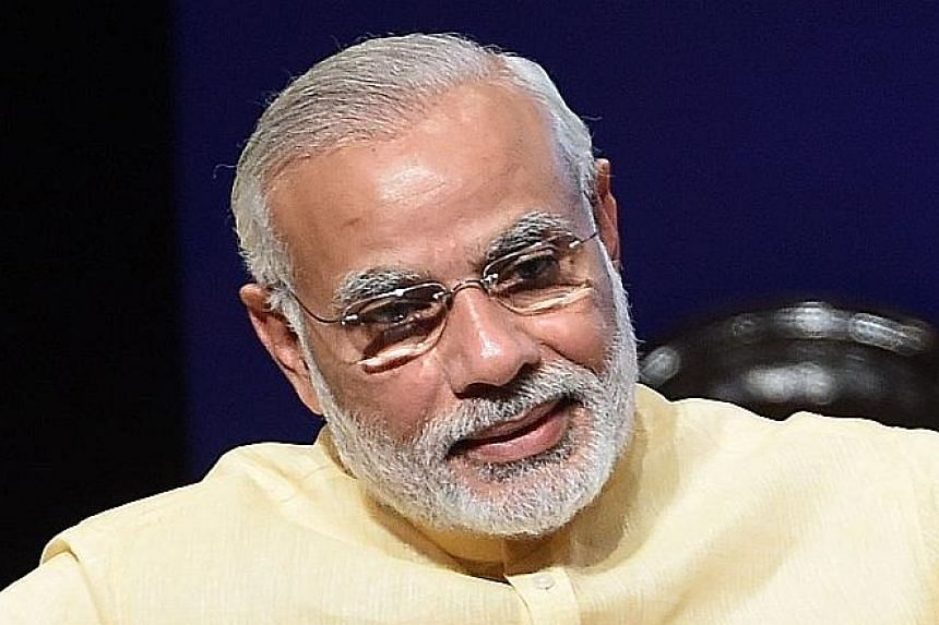 India's Prime Minister Narendra Modi looks forward to deeper ties. US ambassador Kirk Wagar said Singaporeans demonstrated commitment to free elections. MCA president Liow Tiong Lai said the PAP's mandate is for continuous development. Penang Chief M