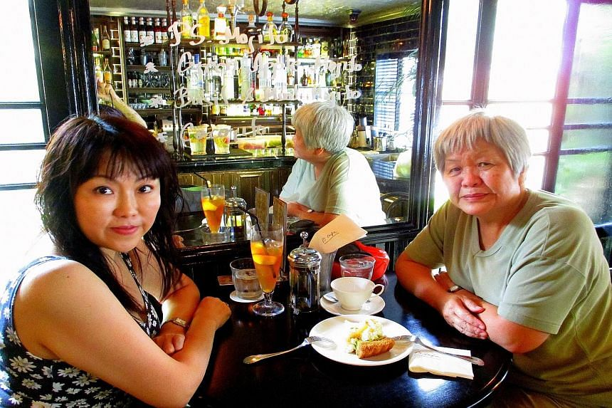 Ms Amy Lam (right) with her niece Daisy Chua at a cafe in Ann Siang Hill. Recounting her secondary school days, Ms Lam says she can swim long distances but not fast - and has tested her endurance by completing the Appalachian Trail in the US over 127