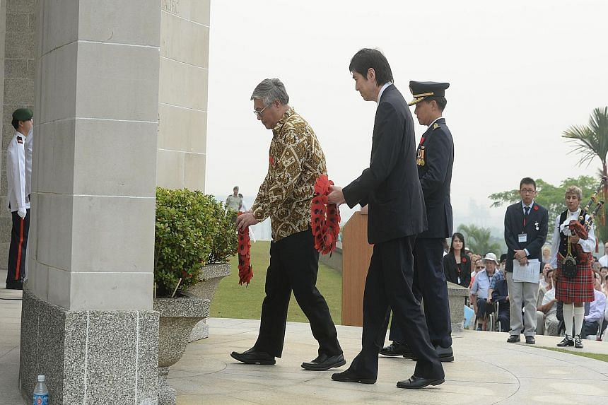 (Far left) Prof Walter Woon, Japanese Ambassador Haruhisa Takeuchi and Colonel Joseph Tan Boon Kiat, Director Nexus of the Defence Ministry, laying wreaths during the remembrance ceremony (left), which was held by The Changi Museum at the Kranji War