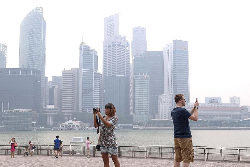 The financial district was shrouded in haze yesterday afternoon. The 24-hour PSI was within the moderate range of 51 to 100 for most of yesterday before creeping into unhealthy levels in the evening.