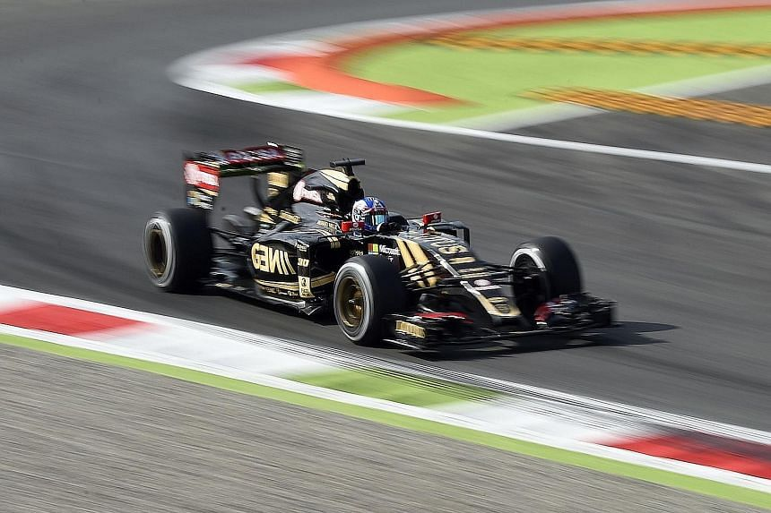 Romain Grosjean finished third at the Belgian Grand Prix but the team's cars were impounded. Lotus say the dispute, part of a legal action brought by former reserve driver Charles Pic, has been resolved.