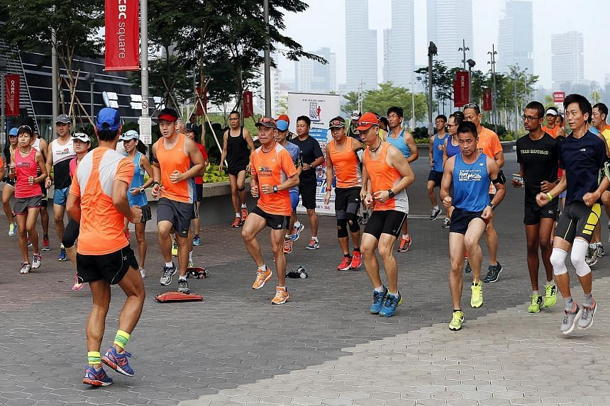Participants of the upcoming The Straits Times Run at the Hub taking part in drills by official pacers Team FatBird at the Singapore Sports Hub yesterday. A 15km training run was also held to help them prepare for the Sept 27 event.