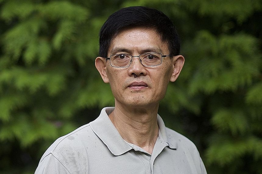 """Professor Xi Xiaoxing, choking back tears, said he """"barely came out of this nightmare""""."""