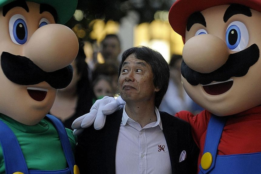Mario's creator Shigeru Miyamoto posing with the game's iconic stars Mario and Luigi. To mark 30 years since its initial launch, Nintendo is releasing a new version of the game with a creative format.
